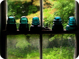 Blue insulators on sill