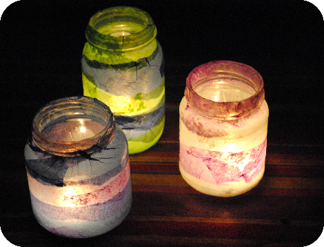 Tea lights placed into glass jars make wonderfully colorful lanterns to  illuminate a quiet evening :.